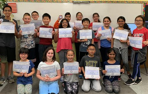 Students proudly displaying their certificates!