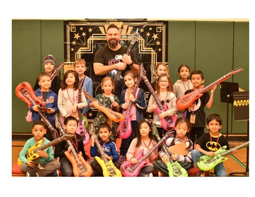 gORUP OF CHILDREN, INFLATABLE GUITARS AND JARED