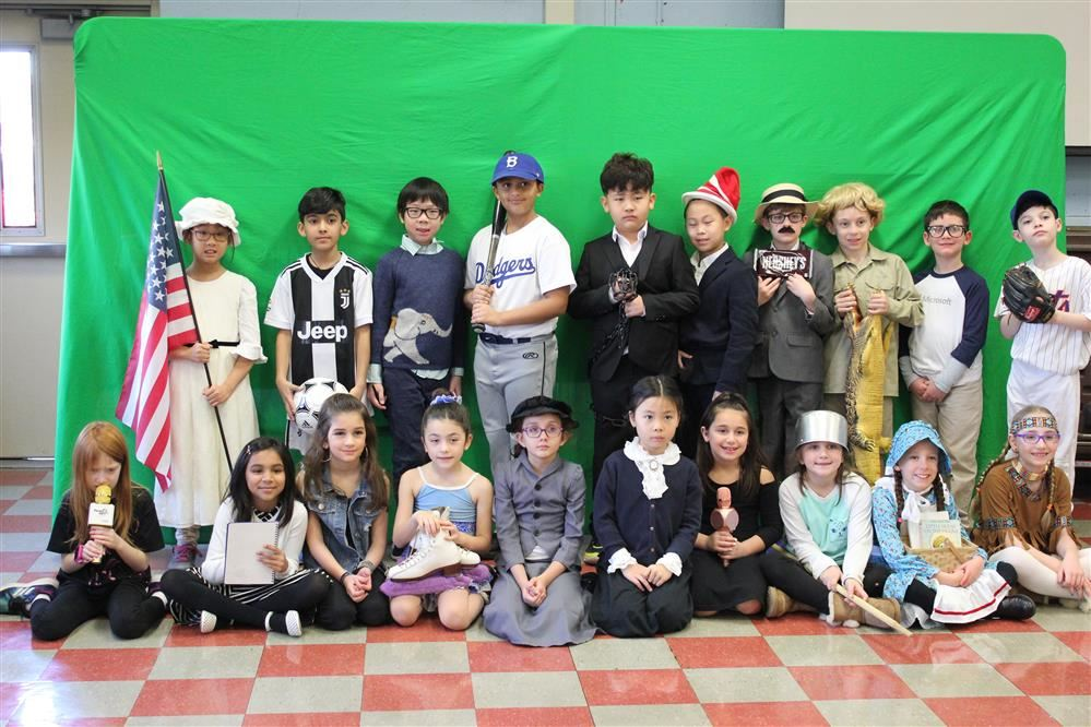 A third grade class is dressed in characters