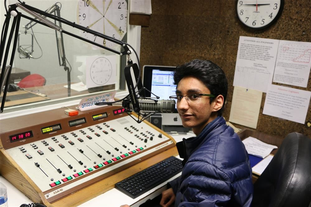 A student works at the high school radio station WKWZ