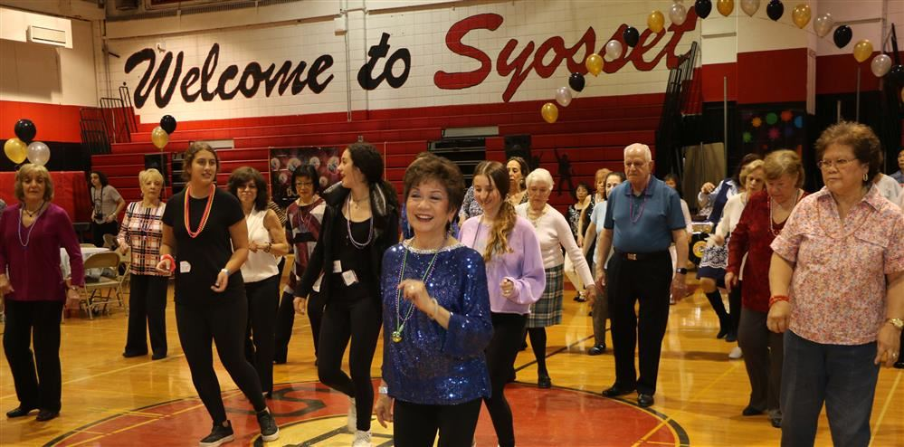 Attendees at the Senior Citizen Prom dance in the gym