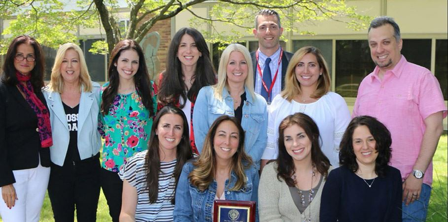 Guidance team poses with their award and Assistant Principal Mr. Ruffini