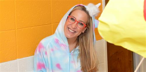 Mrs. McMahon dressed as a baby unicorn.