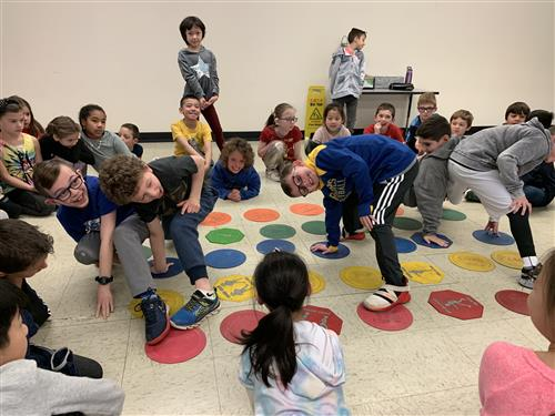 Students cooperatively playing on Global Play Day.