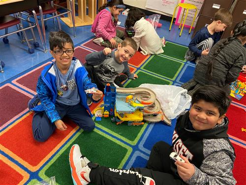 2nd graders building a car port.