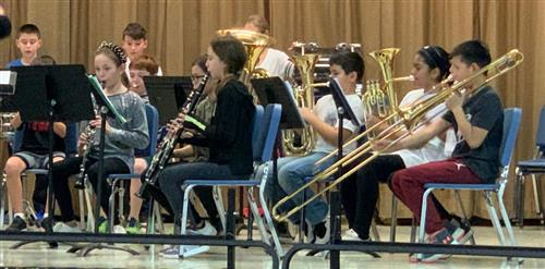 The brass and woodwind section.