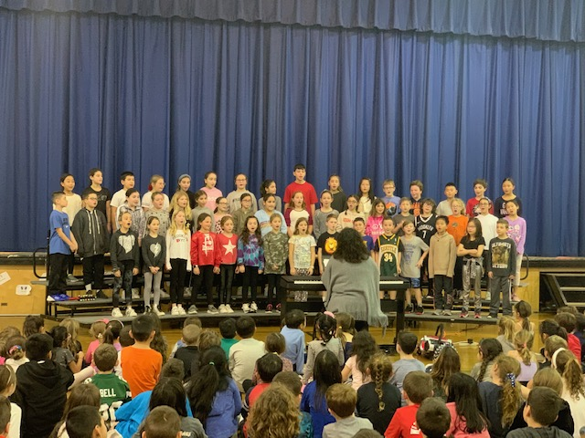 The fourth and fifth grade chorus singing.