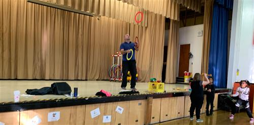 Mr. Fitzgerald juggling rings.