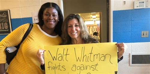 2 teachers holding a sign that says... Walt Whitman Fights Against Pediatric Cancer.