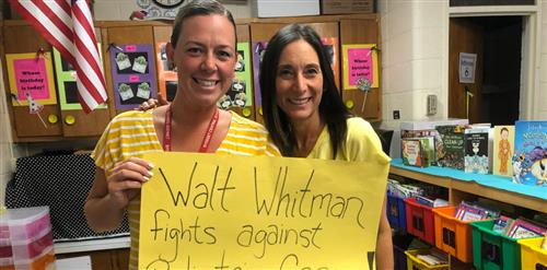 Two teachers holding a sign that says... Walt Whitman Fights Against Pediatric Cancer.