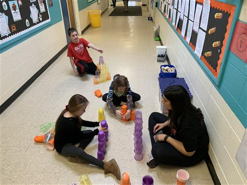 Third graders playing with solo cups.