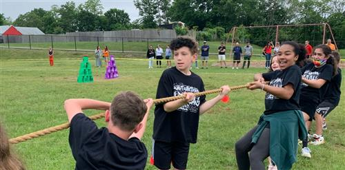 Third graders doing splits on a twister board.