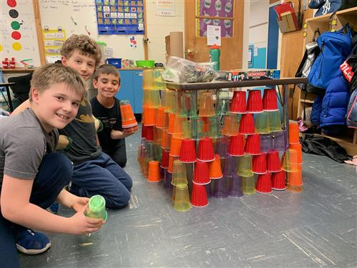 Third Graders build a cup fort.
