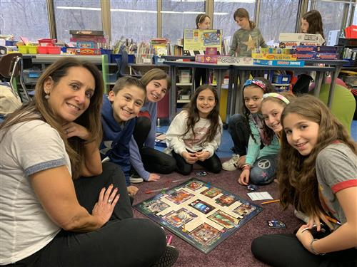 Fourth graders playing Clue.