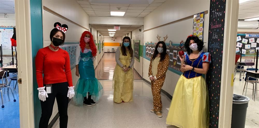 Teachers dressed up in Halloween costumes.