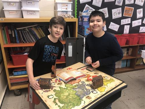 Fifth Graders playing a board game.