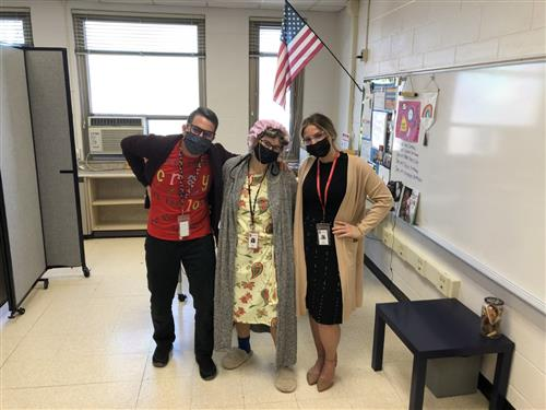Three teachers dressed up for the 100th day of school.