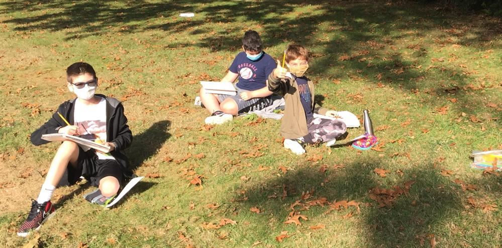 Students sketching leaves