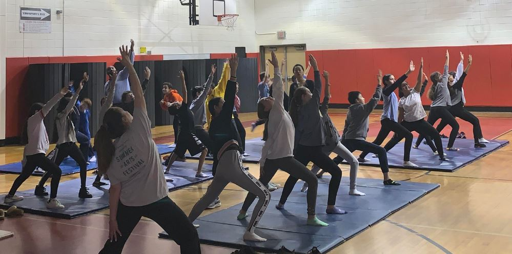 Students participating in mindful yoga during Wellness Week