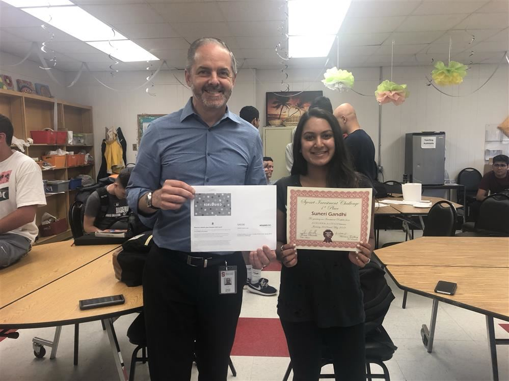 Suneri Gandhi receives an award from Mr.Barrella and Investment Club for her outstanding performance