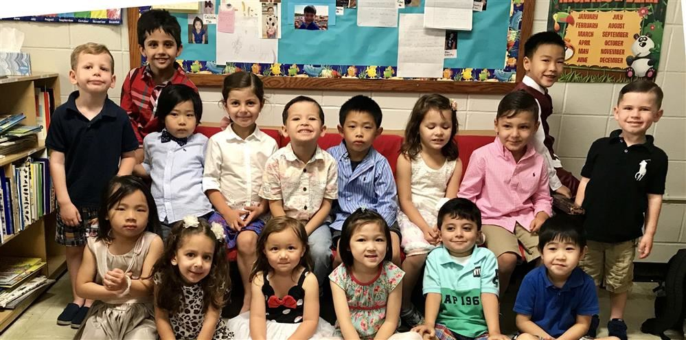 Pre-K students pose as a group during their graduation ceremony