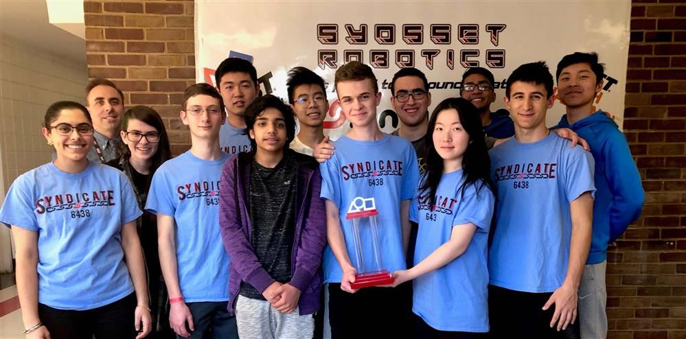 Robotics students pose with their trophy